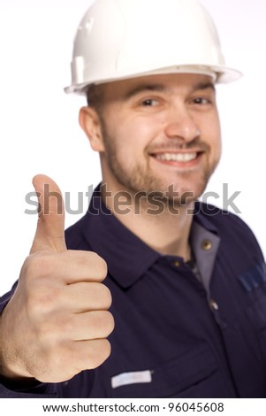 Portrait of a builder in a white helmet on a white background - stock photo