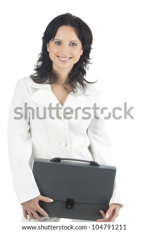 portrait of a busineslady standing in white suite and holiding black briefcase isolated over white background