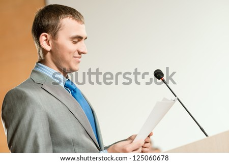 Portrait of a business man holding documents and looks at them