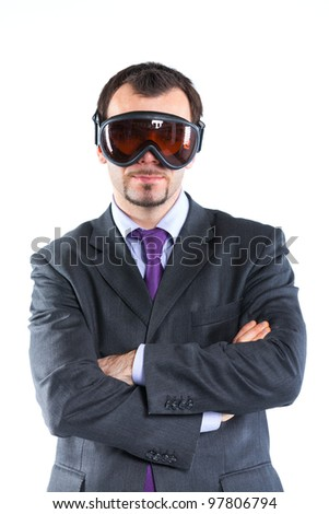 Portrait of a  business man in ski goggles isolated on white background. Studio shot.