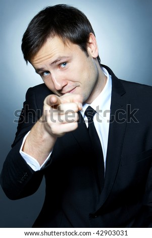 Portrait of a business man pointing at you