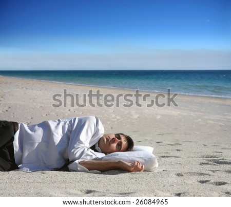 portrait of a business man sleeping on the beach