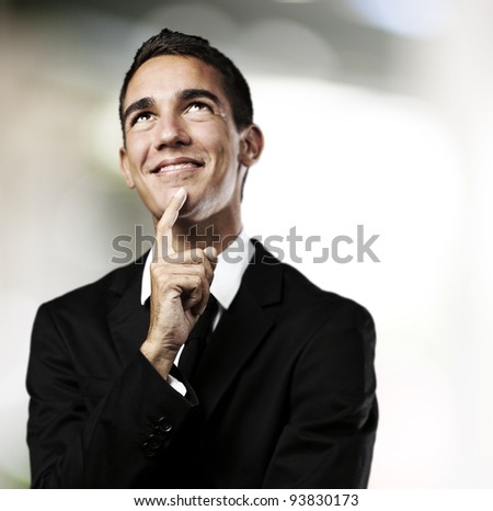 portrait of a business man thinking against an abstract background