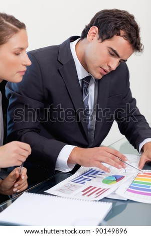 Portrait of a business team studying statistics in a meeting room