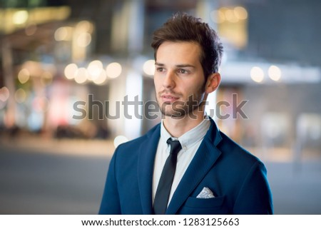 Portrait of a businessman at night #1283125663