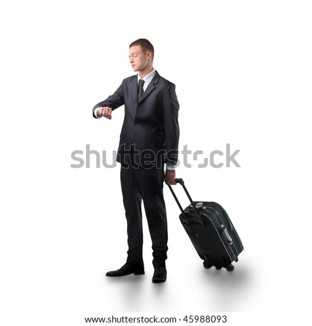 Portrait of a businessman carrying a suitcase and looking at his watch