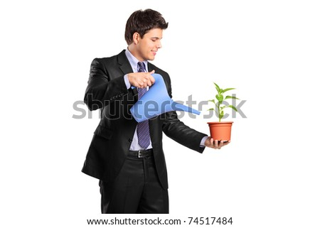 Portrait of a businessman holding a flower and watering can isolated on white background