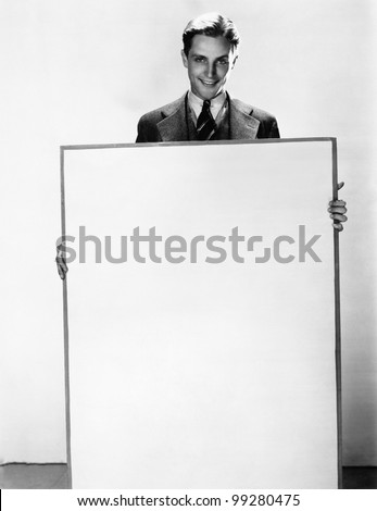Portrait of a businessman holding a poster and smiling