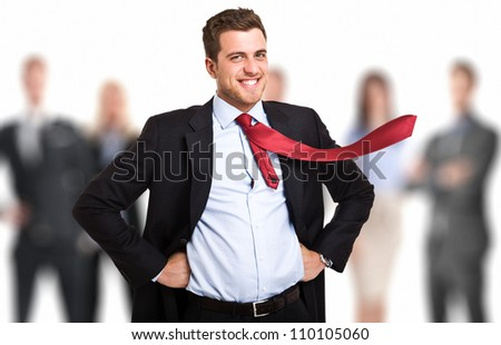 Portrait of a businessman in front of his team