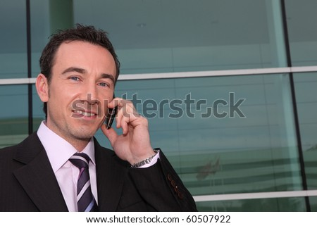 Portrait of a businessman on mobile phone