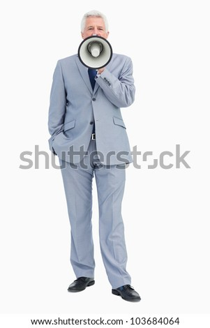 portrait of a businessman shouting with megaphone against white background