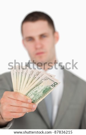 Portrait of a businessman showing notes against a white background