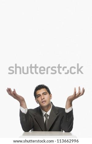 Portrait of a businessman shrugging