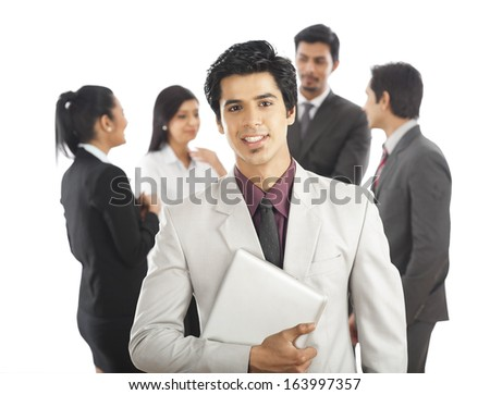 Portrait of a businessman smiling with his colleagues in the background Photo stock ©