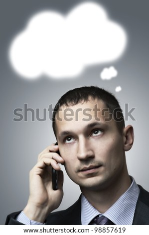 Portrait of a businessman thinking about something and speaking by cellphone