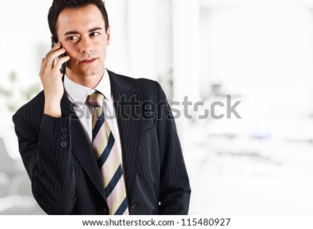 Portrait of a businessman using a cell phone
