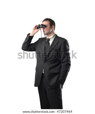 Portrait of a businessman using a pair of binoculars