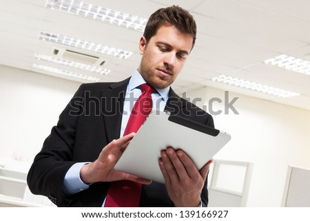 Portrait of a businessman using a tablet