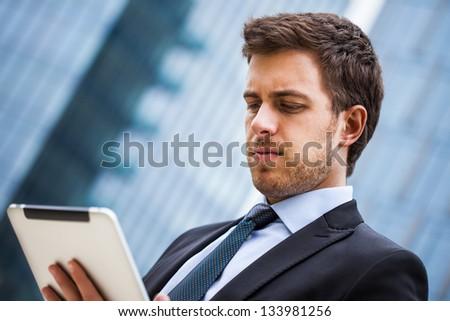 Portrait of a businessman using a tablet pc