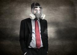 Portrait of a businessman wearing a gas mask