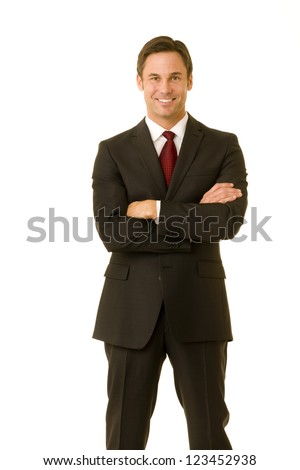Portrait of a businessman wearing a suit smiling with his arms folded