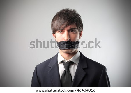 Portrait of a businessman with a bandage on his mouth