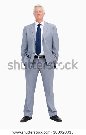Portrait of a businessman with his hands in his pockets against white background
