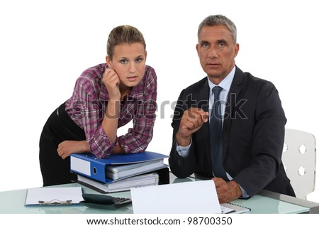Portrait of a businessman with his secretary