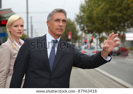 portrait of a businessteam on the street - stock photo