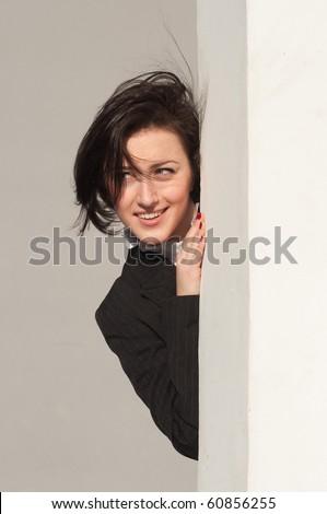 Portrait of a businesswoman behind the corner