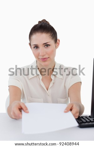 Portrait of a businesswoman giving a document against a white background