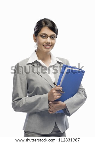 Portrait of a businesswoman holding a file and standing against a white background