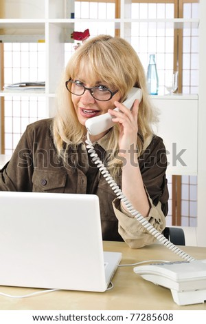 Portrait of a businesswoman on the telephone. Office background.