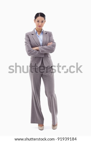 Portrait of a businesswoman posing with the arms crossed against a white background
