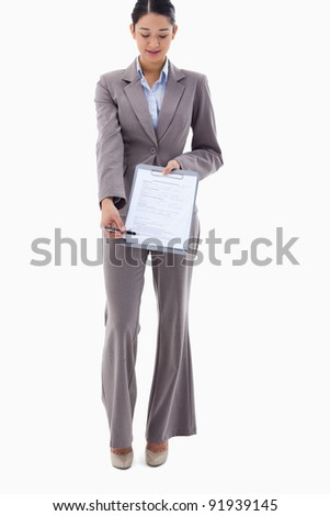Portrait of a businesswoman showing a contract against a white background
