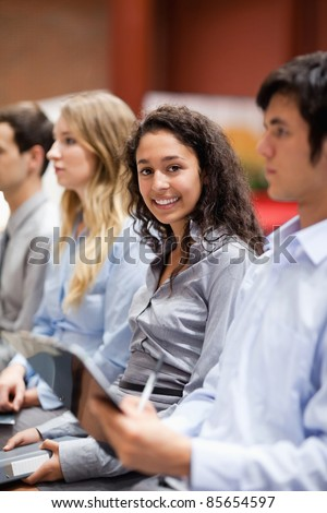 Portrait of a businesswoman smiling at the camera during a presentation