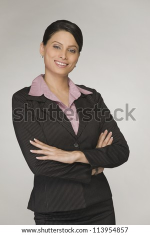 Portrait of a businesswoman smiling with arms crossed