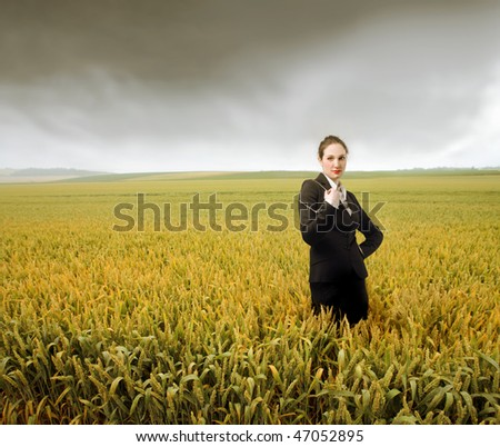 Portrait of a businesswoman standing in a cornfield
