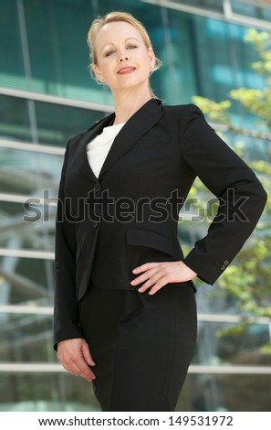 Portrait of a businesswoman standing outside office building