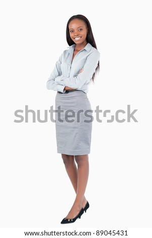 Portrait of a businesswoman with the arms crossed against a white background