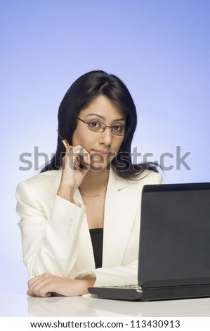 Portrait of a businesswoman working on a laptop