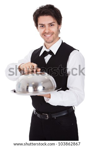 Portrait of a butler with bow tie and tray. Isolated on white