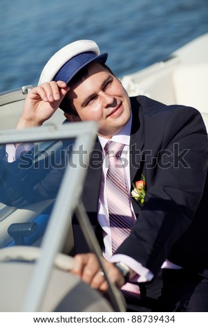 portrait of a Captain managing the yacht