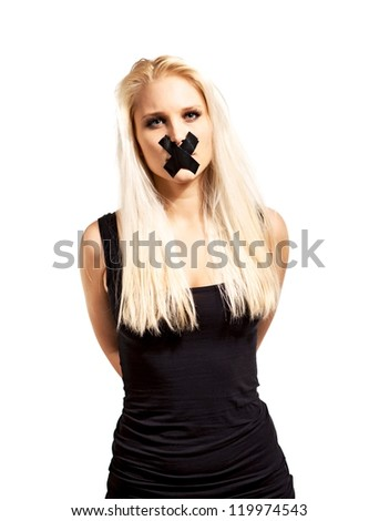 Portrait of a captive woman tied up and silenced by a tape over her mouth - stock photo
