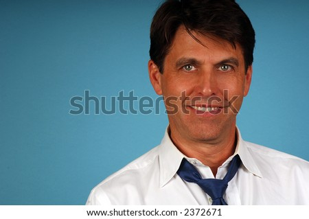 Portrait of a Casual business man with loose shirt and tie