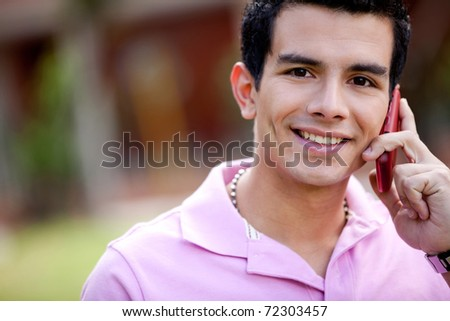 Portrait of a casual man talking on the phone outdoors