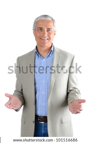 Portrait of a casual middle aged man wearing blue jeans, dress shirt and a sport coat. Man has both hands extended in front of himself over a white background.