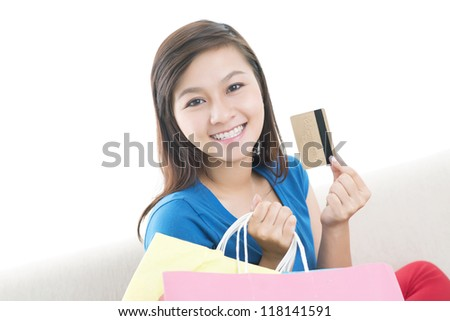 Portrait of a charming girl with shopping bags and credit card