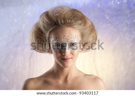 portrait of a charming young woman with make-up of crystals in the studio - stock photo