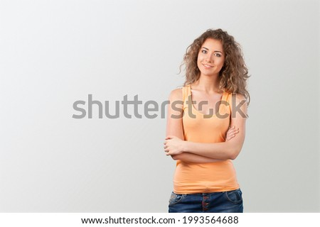 Portrait of a cheerful, adult girl laughing stand on a background